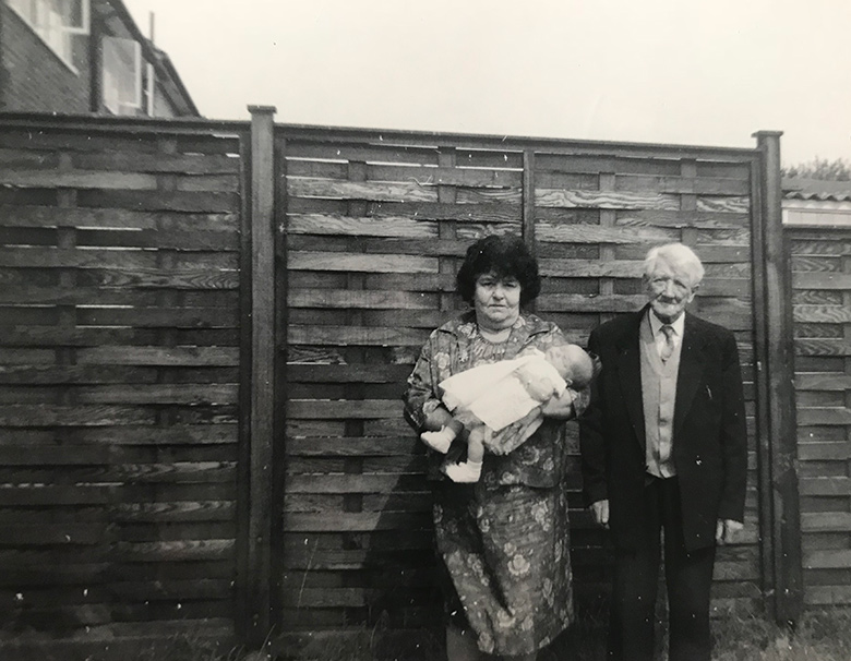 My great grandma and great grandad with my mum in their garden in Roundtable Road